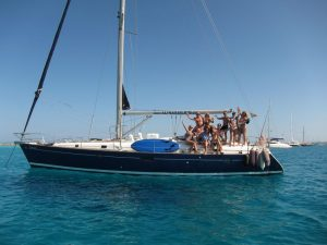 Boat trips Mar Menor to Tabarca with all your family or fiends on board our luxury sailboat Beneteau Oceanis 50 with blue hull